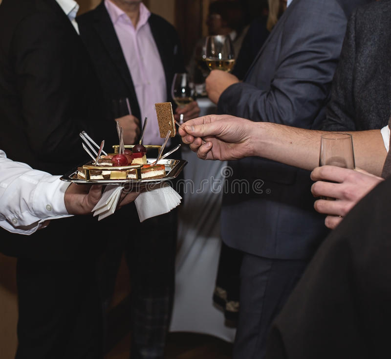 canape dish held by waiter royalty free stock photos