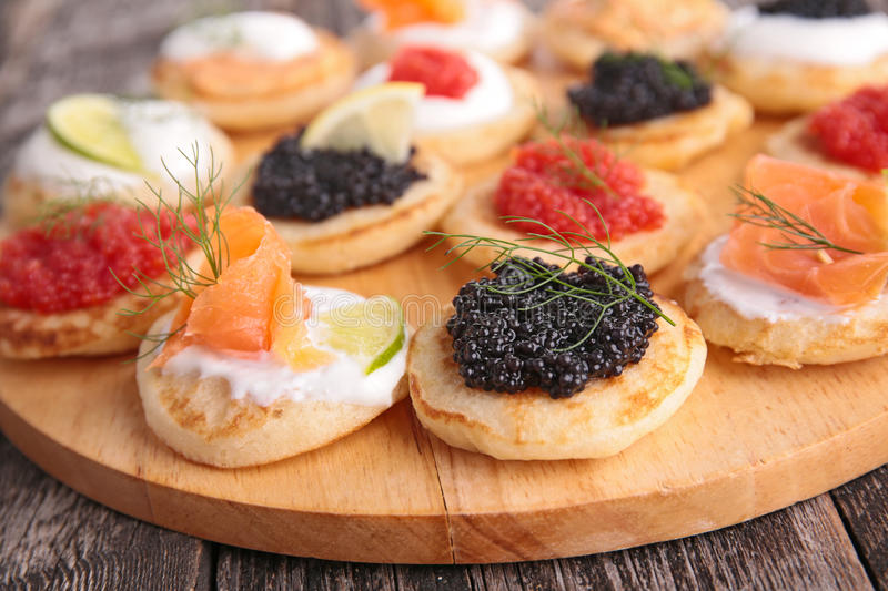 Canape, finger food. Close up on canape, finger food royalty free stock photo