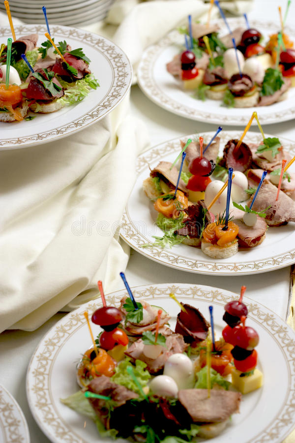 Canape on a plates royalty free stock photos