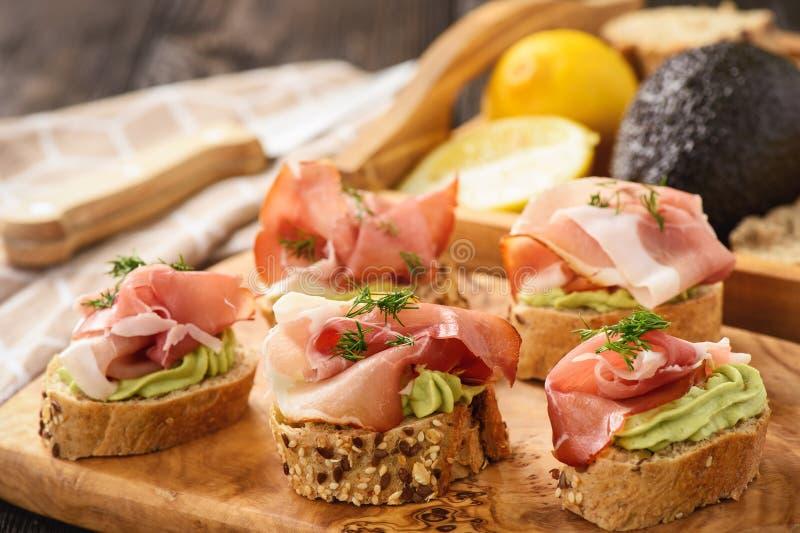 Canape with procciutto and guacamole, italian style cuisine. Canape with procciutto and guacamole, italian style cuisine stock photography