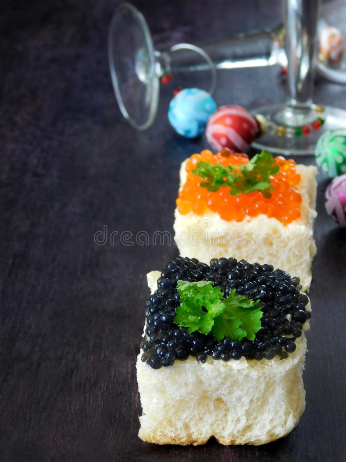 Canape with red and black caviar stock image