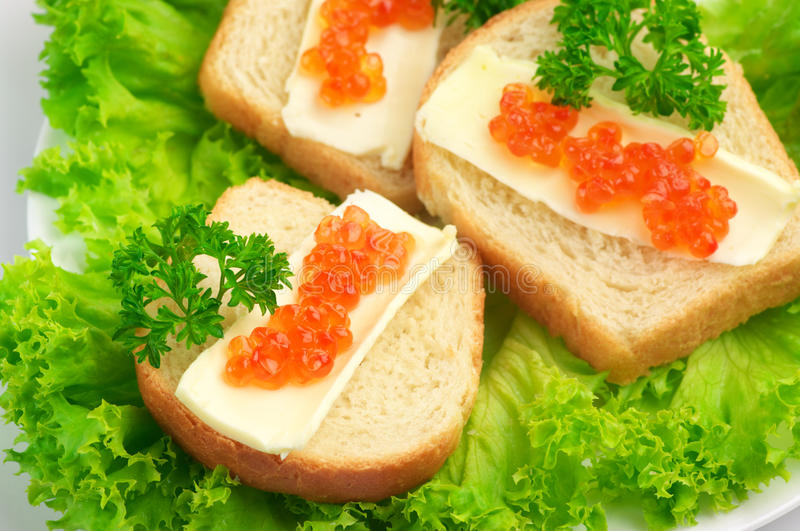 Canape with salmon caviar royalty free stock image