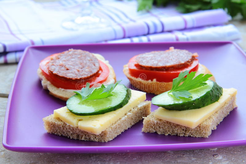 canape sandwiches with cheese and salami stock photography