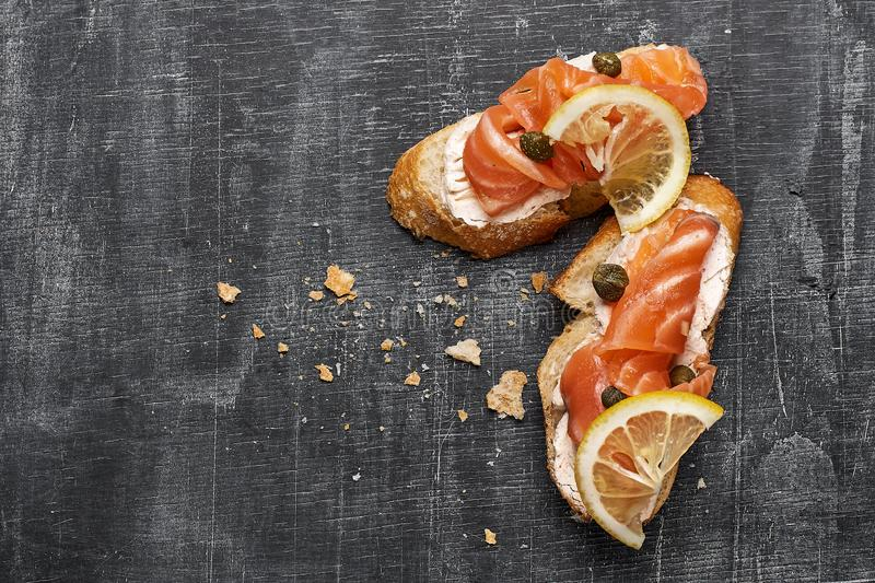 Canape with smoked salmon and cream cheese, selective focus, top view stock images