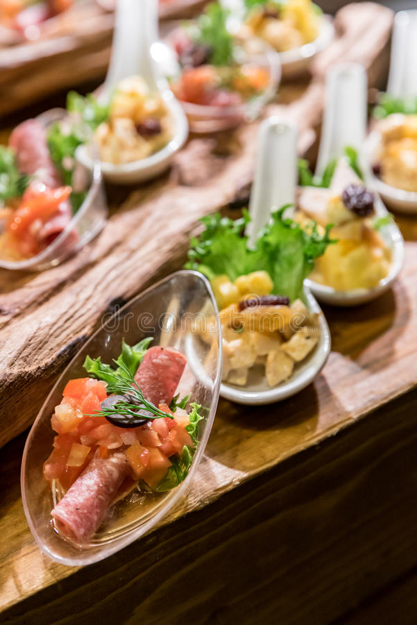 Canape on spoon stock images