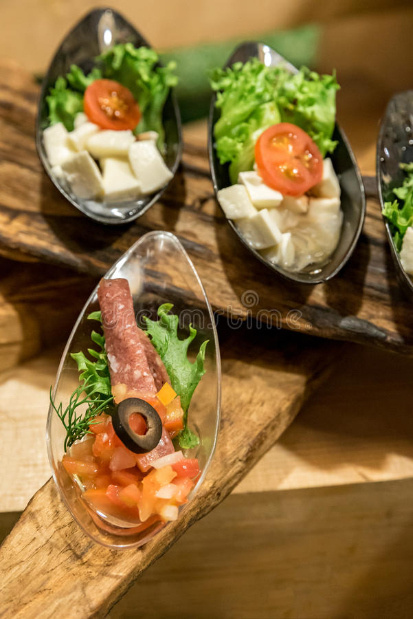 Canape on spoon royalty free stock photo