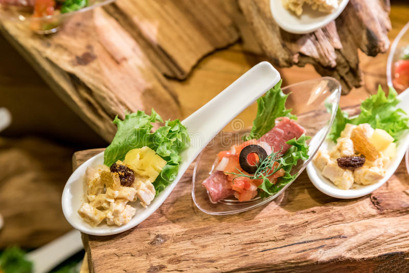 Canape on spoon stock image