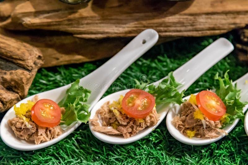 Canape on spoon stock photos