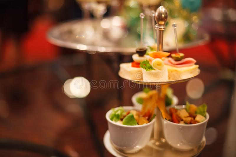 Canapes Assortment on silver tray on table background. Hotel venue restaurant food catering service buffet, cocktail banquet for w. Edding ceremonies, seminars stock images