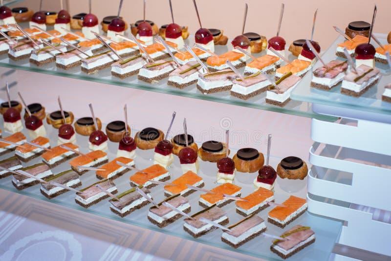 Canapes at buffet table royalty free stock photo