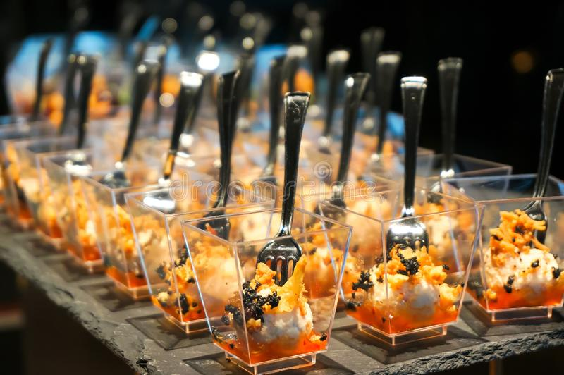 Canapes on the buffet table. Stand-up meal. Close up stock photography
