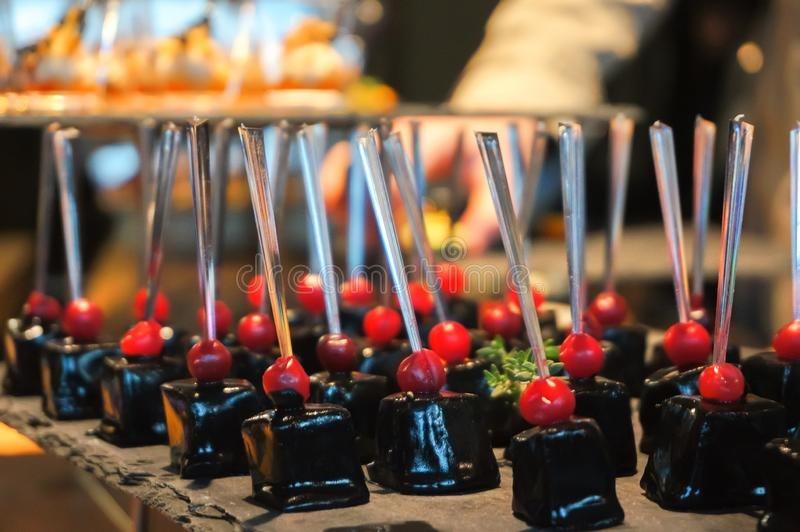 Canapes on the buffet table. Stand-up meal. Close up royalty free stock photo