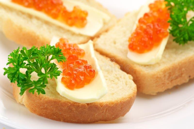 Canapes com caviar salmon fotografia de stock