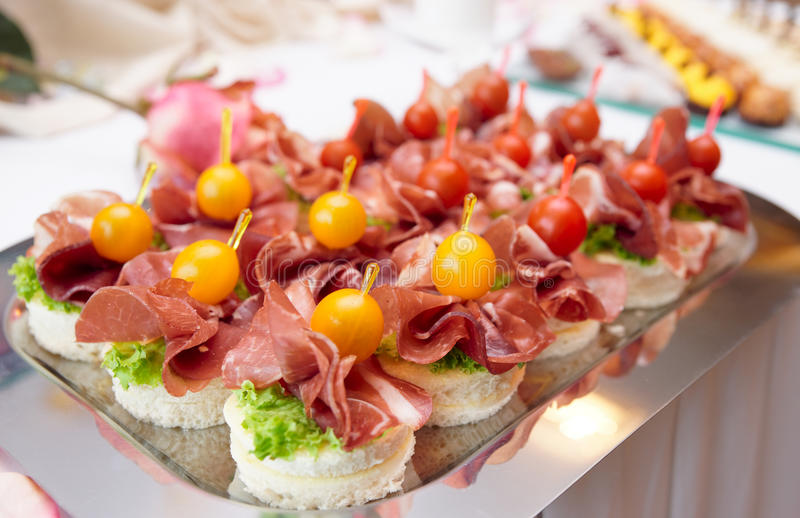 Download Canapes with cured ham stock image. Image of food, metal - 15963187