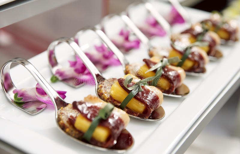 Canapes with cured ham on banquet table stock images