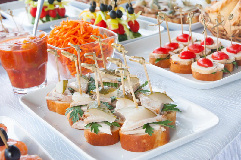 Canapes on the white plates. Mini canapes on white plates in daylight stock photos