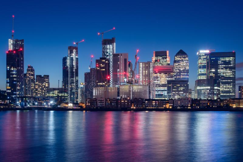 Canary Wharf Business District Skyline at Night. Night Time Skyline View of Modern Business District Canary Wharf in London, UK stock photo