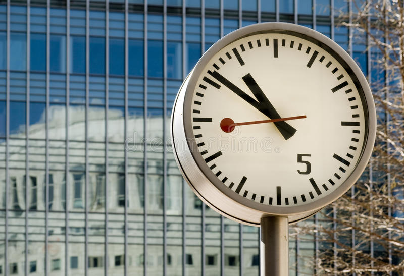 Canary Wharf Clock. London financial district in Canary Wharf with a large number of clocks showing the world's time royalty free stock photo