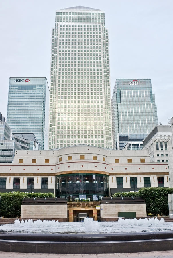 Canary Wharf London City, England. Skyscrapers and modern architecture financial office buildings and water fountain of Cabot place in Canary Wharf in London royalty free stock photography