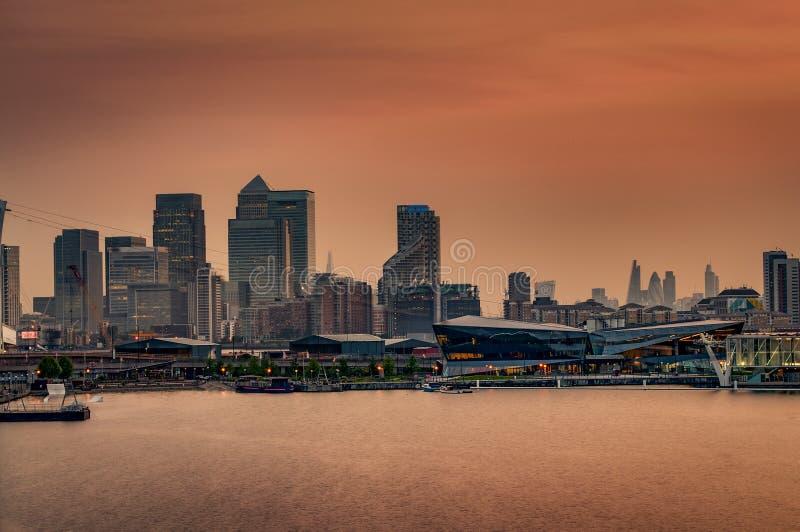 Canary Wharf, London, England at sunset stock photos