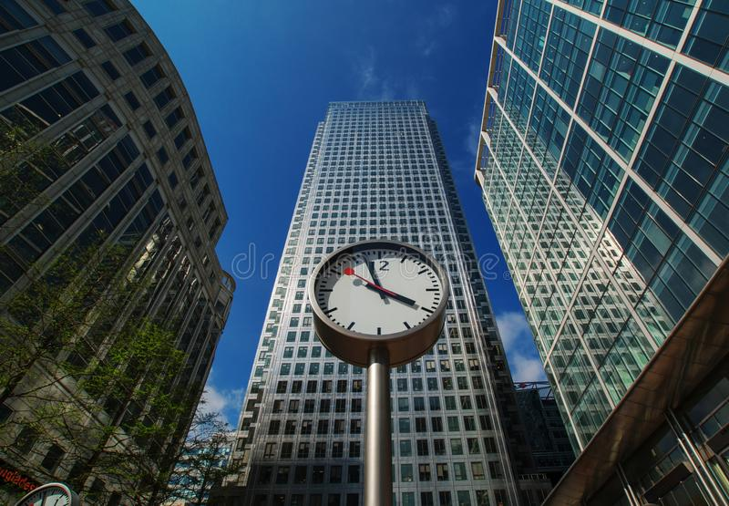 Canary Wharf. In London`s financial district was installed part of sculpture Six Public Clocks by Konstantin Grcic in 1999. stock photography