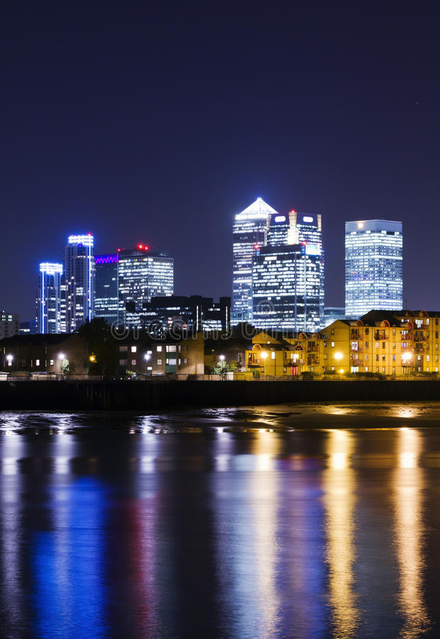 Canary Wharf by night. Canary Wharf at dusk, Famous skyscrapers of London's financial district by night. This view includes: Credit Suisse, Morgan Stanley, HSBC stock photo