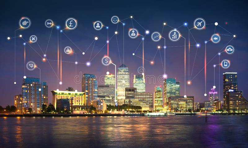 Canary Wharf and river Thames at sunset. Illustration with communication and business icons, network connections concept. Modern skyscrapers and financial aria stock images