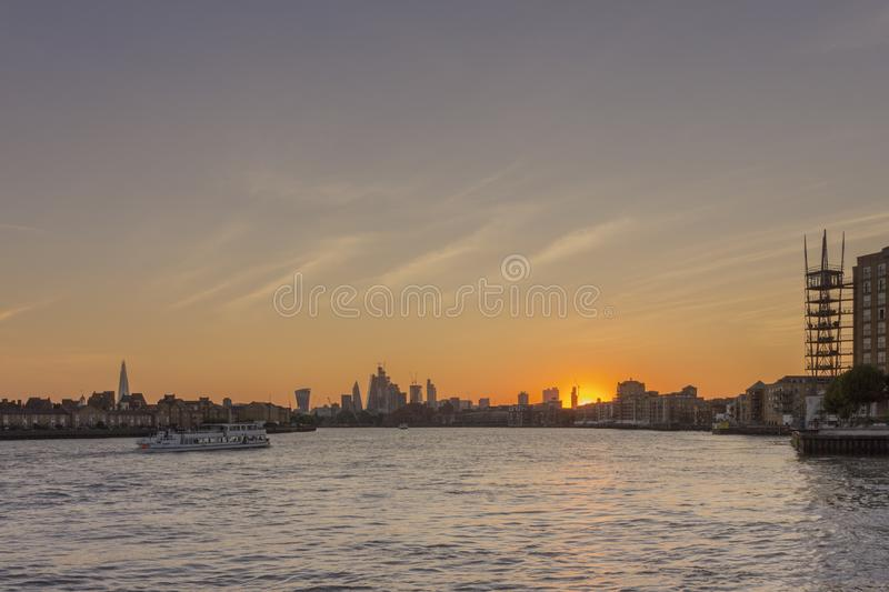 Canary wharf riverside sunset cloudscape view, London city. stock photos