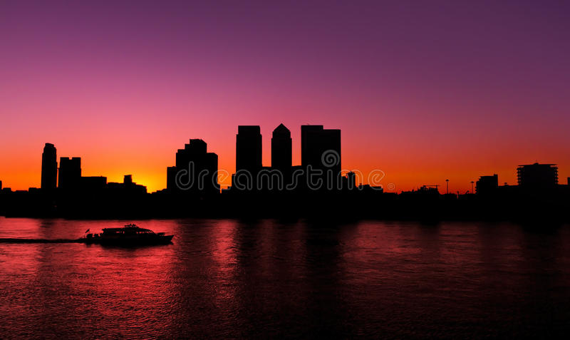 Canary Wharf, summer sunset. Canary Wharf area of London at sunset. Silhouette (Blacklit royalty free stock photos