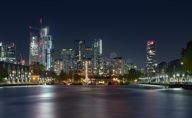 Canary Wharf view from docks. Canary Wharf night view from London docks. Long exposure image stock photos