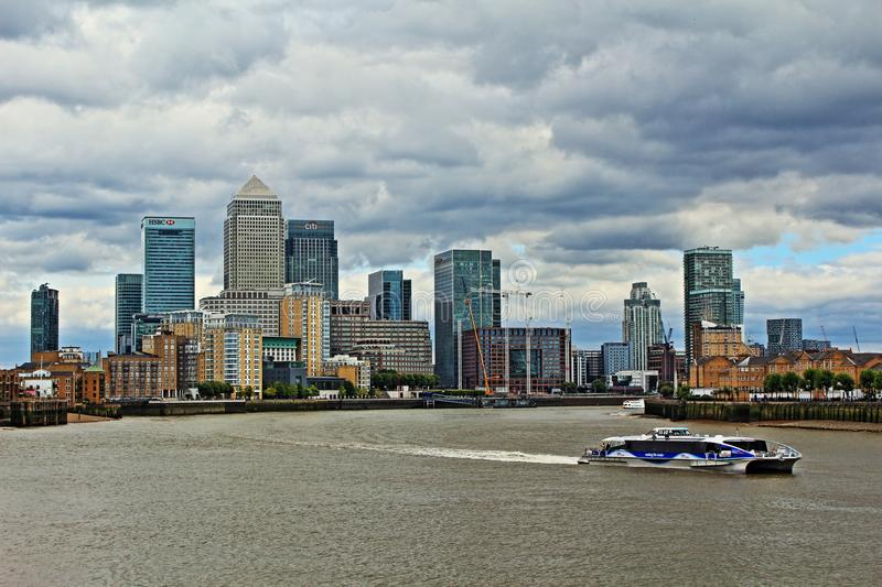 Darkening skies over London United Kingdom. Canary Wharf viewed from the west.Canary Wharf is a major private estate owned by Canary Wharf Group in Greater royalty free stock photo