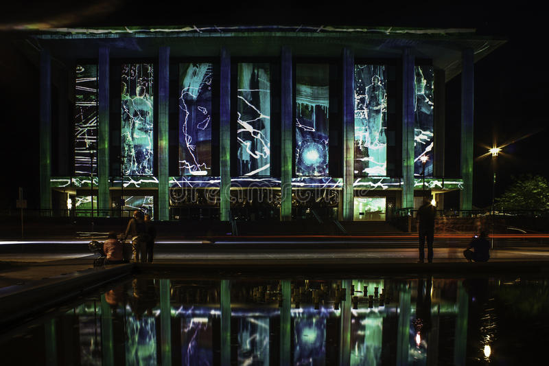 Canberra Enlighten Festival National Library. Film projection on walls with reflection in pool royalty free stock image
