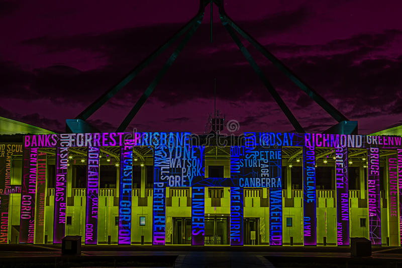 Canberra Enlighten Festival New Parliament Hou. Se. Film projection on walls with reflection in pool stock photos