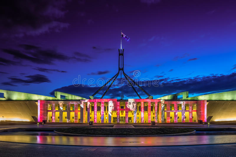 Canberra Enlighten Festival New Parliament Hou. Se. Film projection on walls with reflection in pool royalty free stock photography