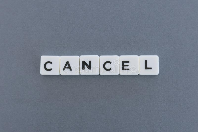 Cancel word made of square letter word on grey background stock photo