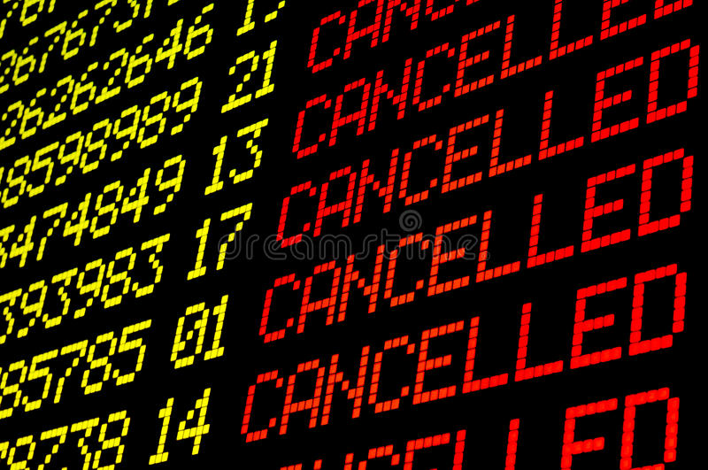 Cancelled flights on airport board. Panel stock image