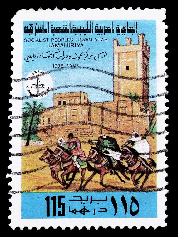 Libya on postage stamps. Cancelled postage stamp printed by Libya, that shows Libyan Fort and horses racing, circa 1978 royalty free stock photo