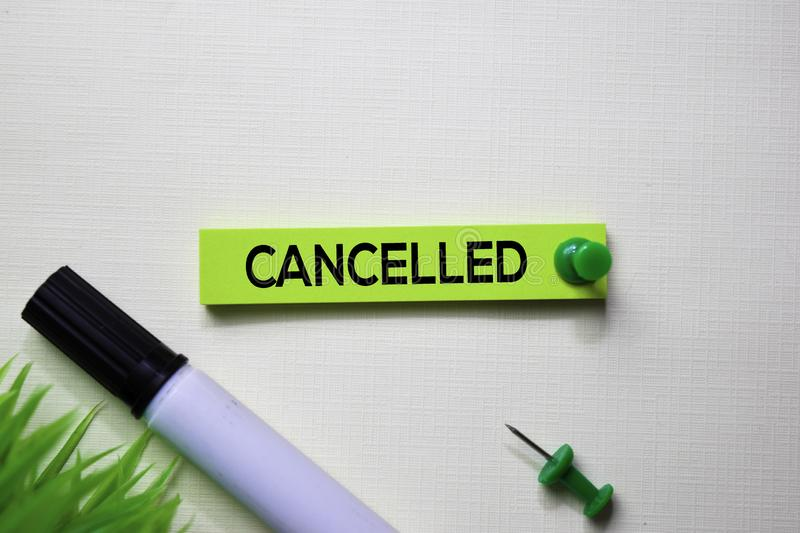 Cancelled text on sticky notes isolated on office desk stock photography
