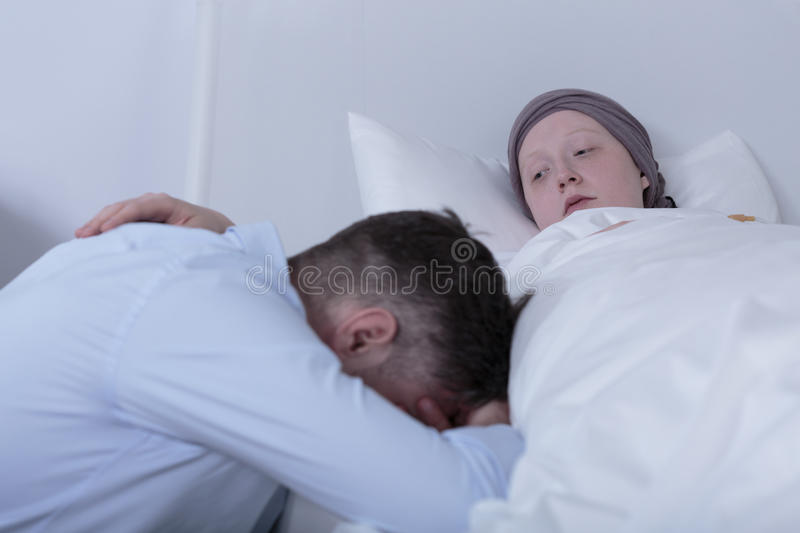 Cancer child comforting despair father stock image