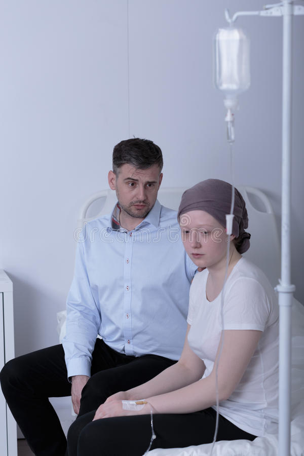 Cancer girl during chemotherapy treatment. In hospital stock image