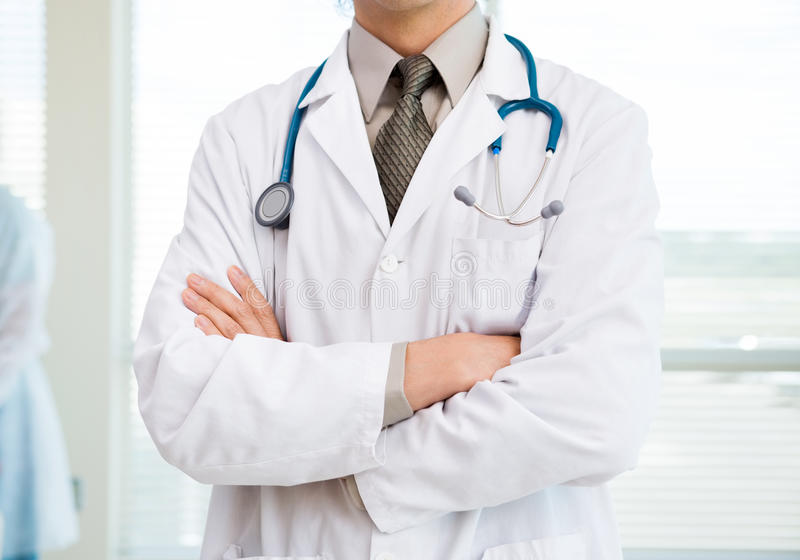 Cancer Specialist Standing Arms Crossed In stock image