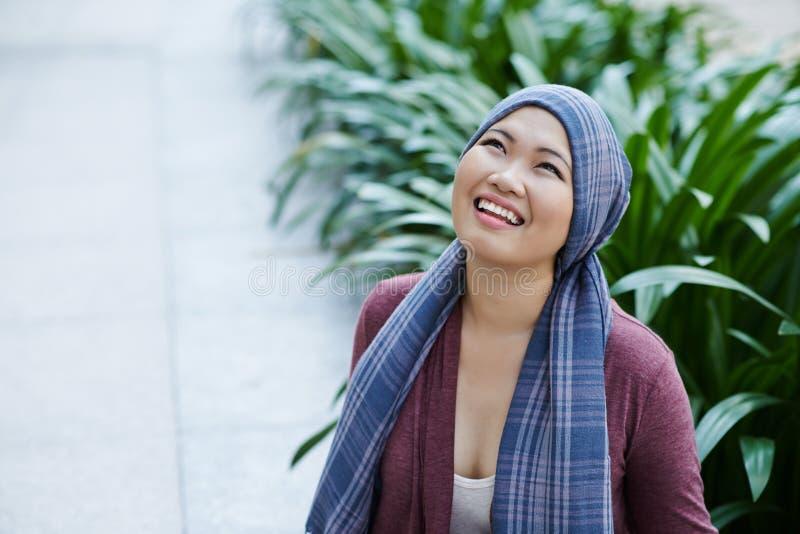 Cancer survivor. Portrait of female cancer survivor in headscarf royalty free stock images