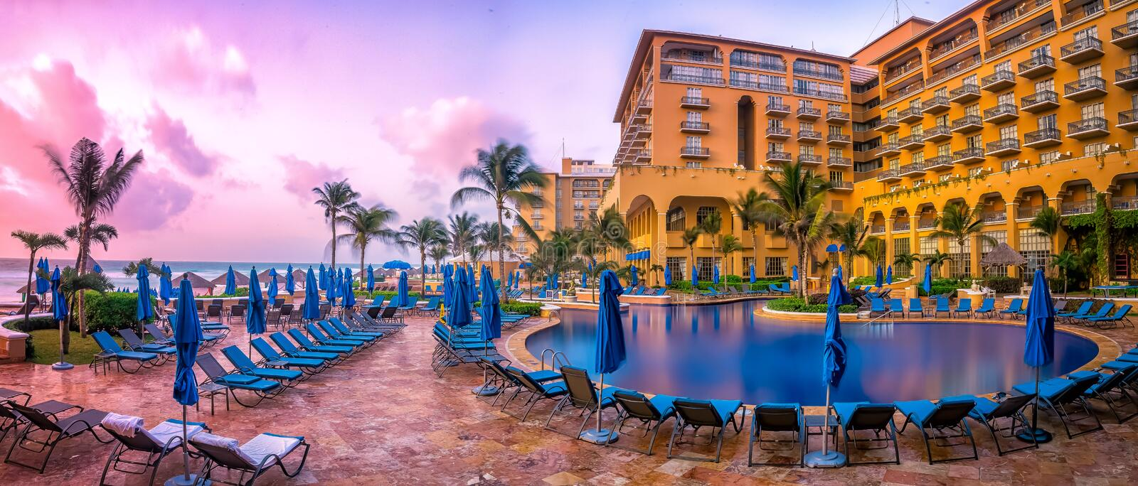 Cancun beach resort with palms. A beach resort in Cancun with ocean and palm trees stock images