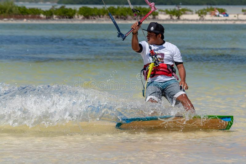 CANCUN, MEXICO - 02/18/2018: Adrenalin Kitesurf. Adventure sport. S Competition, Freestyle jumping at Mexican Caribbean royalty free stock photo