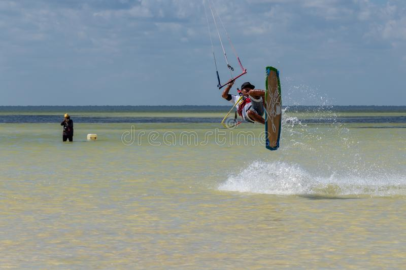 CANCUN, MEXICO - 02/18/2018: Adrenalin Kitesurf. Adventure sports Competition, Freestyle jumping at Mexican Caribbean. Adrenalin kitesurf on a sunny day royalty free stock photos