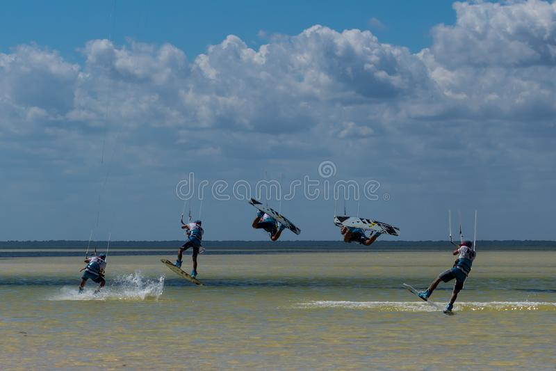 CANCUN, MEXICO - 02/18/2018: Adrenalin Kitesurf. Adventure sports Competition, Freestyle jumping at Mexican Caribbean. Adrenalin kitesurf on a sunny day stock photography