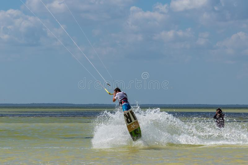 CANCUN, MEXICO - 02/18/2018: Adrenalin Kitesurf. Adventure sports Competition, Freestyle jumping at Mexican Caribbean. Adrenalin kitesurf on a sunny day royalty free stock image