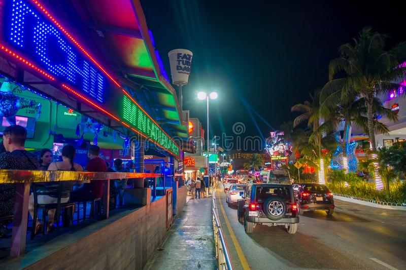 CANCUN, MEXICO - JANUARY 10, 2018: Unidentified people at outdoors enjoying the night life and taking pictures at center stock photo
