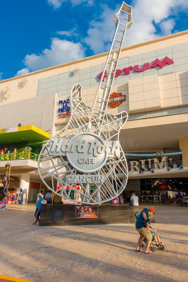 CANCUN, MEXICO - JANUARY 10, 2018: Unidentified people at outdoors next to Hard Rock Cafe metallic guitar structure in stock photo