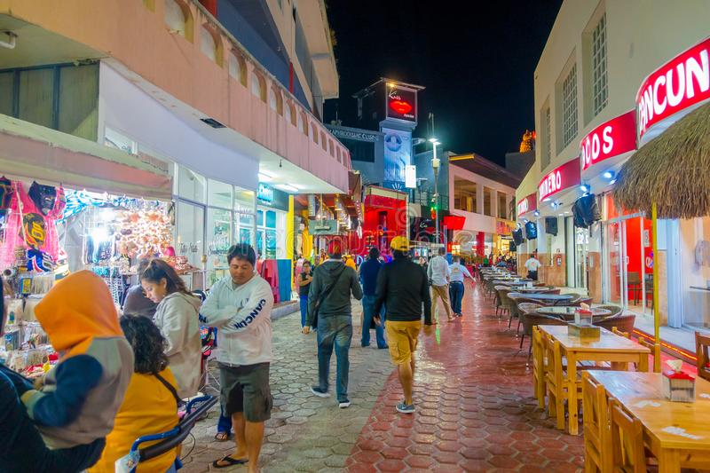CANCUN, MEXICO - JANUARY 10, 2018: Unidentified people at outdoors walking and enjoying the night life at center in stock photo